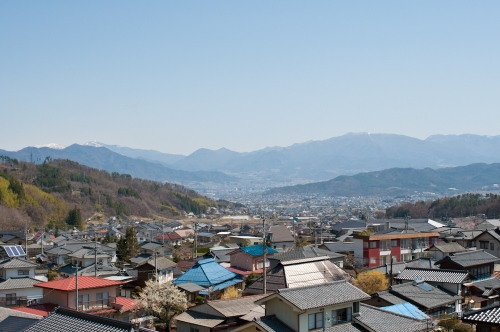 Bessho Onsen, looking down at Ueda in the distance and the Japan Alps on the horizon